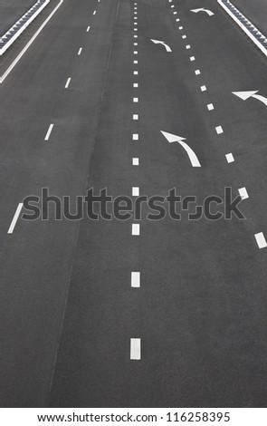 Asphalt road and white line markings,Asphalt road texture - stock photo