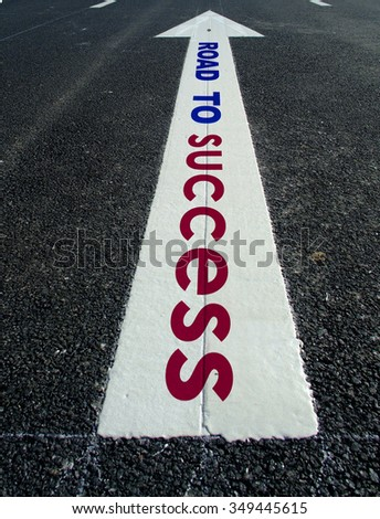 asphalt road arrow write road to success  - stock photo