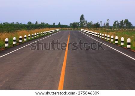 asphalt road at sunset - stock photo