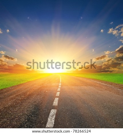 asphalt road at the sunset - stock photo