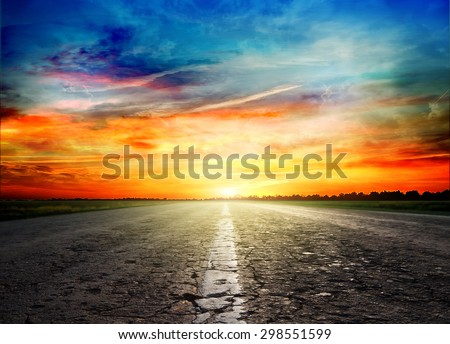 Asphalt road between fields  trees  - stock photo
