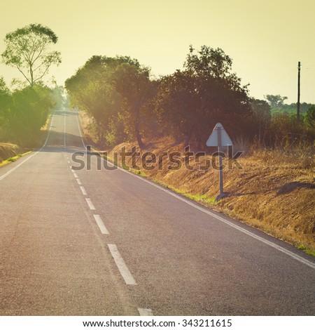 Asphalt Road between Hills in Portugal at Sunrise, Instagram Effect - stock photo