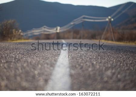 Asphalt road close up photo - stock photo