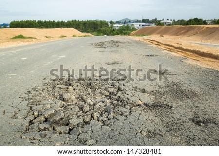 Asphalt road damage. - stock photo