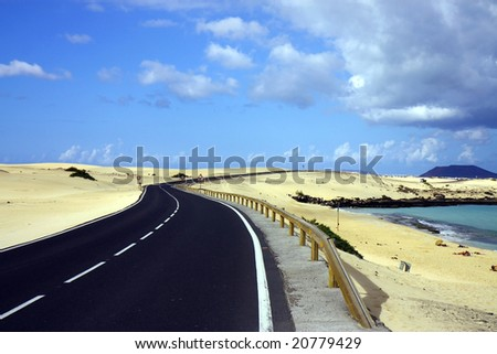 asphalt road in desert - stock photo