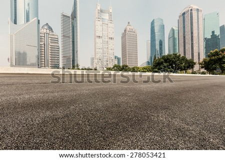 Asphalt road in front of the modern building  in Shanghai?china - stock photo