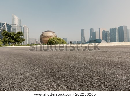 Asphalt road in front of the modern city hangzhou china - stock photo