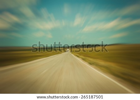 Asphalt road in motion, green and blue landscape, road background, road in future, field - stock photo