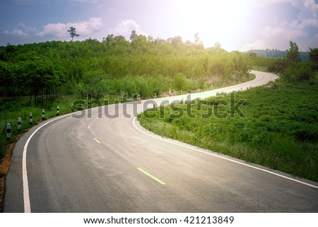 Asphalt road in rural with sunlight - stock photo