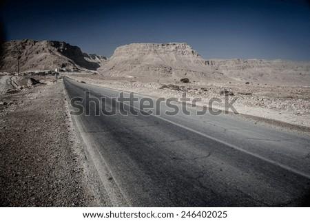 Asphalt Road in Sand Hills of Israel  - stock photo