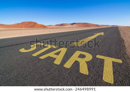 asphalt road in the desert with a yellow arrow and the word START leading to the horizon. Business concept for motivation and success - stock photo