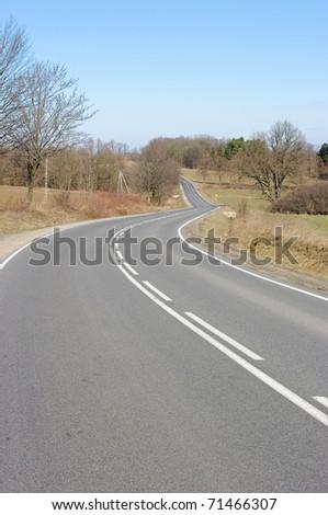 Asphalt road in the hills - stock photo