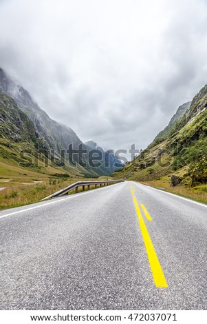 asphalt road in the Norwegian mountains, summer, green, cloudy day