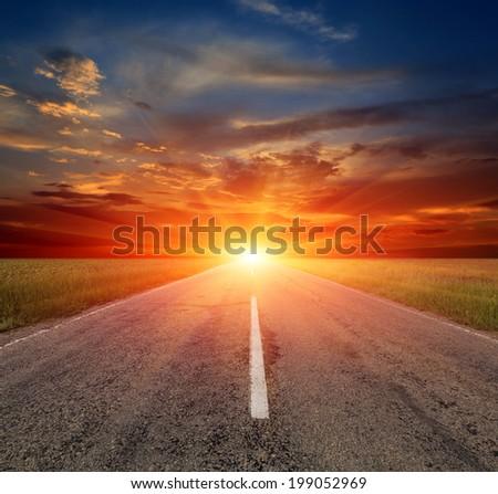 Asphalt road no sunset background - stock photo