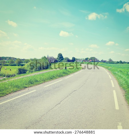 Asphalt Road on the Dam between the Meadows in Holland, Instagram Effect - stock photo