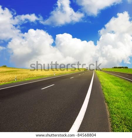 asphalt road over blue sky - travel concept - stock photo