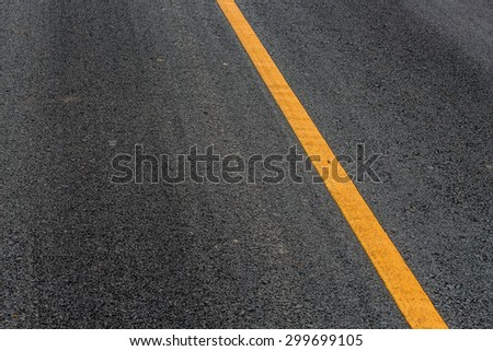 Asphalt road texture background with white dashed line - stock photo