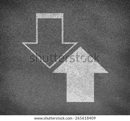 Asphalt road texture with two up and down arrows. Business concept - stock photo