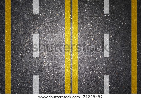 Asphalt road texture with white and yellow stripe