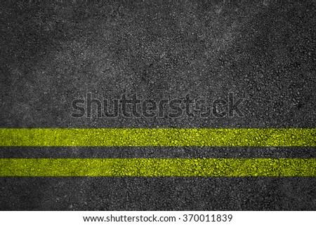 Asphalt Road Texture With Yellow Strip - stock photo