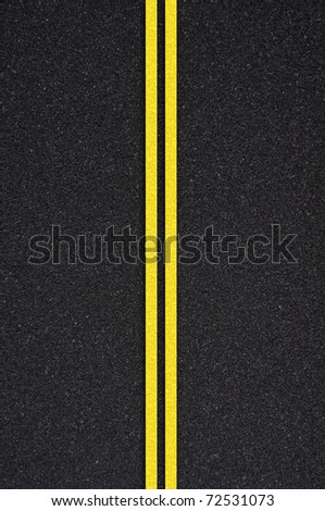 Asphalt road texture with yellow stripe - stock photo