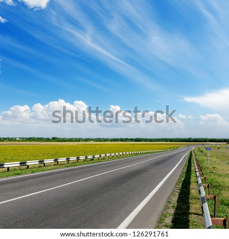 asphalt road to cloudy horizon - stock photo