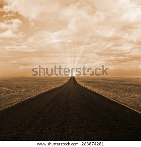 Asphalt road to horizon with sunset sky - stock photo