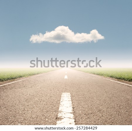 asphalt road to the horizon - stock photo