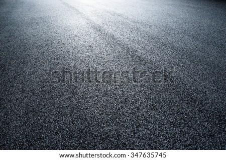 asphalt road under light  - stock photo