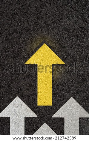 Asphalt road with arrows - stock photo