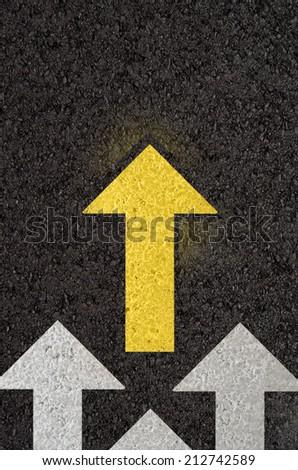 Asphalt road with arrows - stock photo