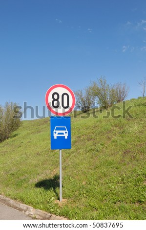 Asphalt road with blue sky and traffic sign
