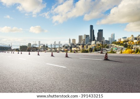 asphalt road with cityscape and skyline of seattle  - stock photo