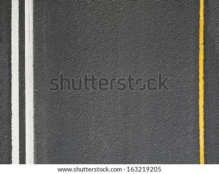 Asphalt road with marking lines. Close-up background texture - stock photo