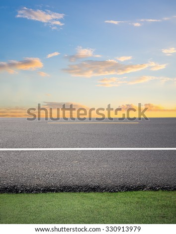 Asphalt road with sky background. - stock photo