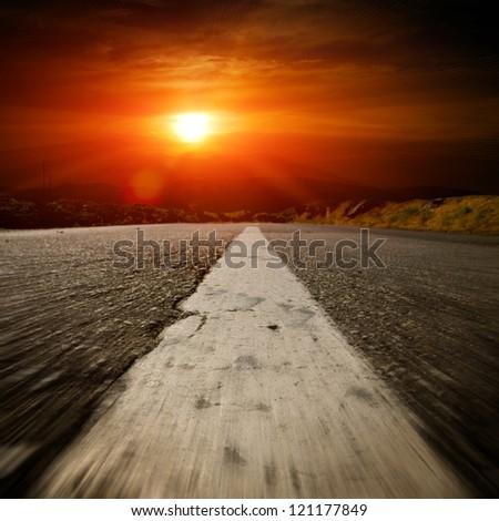 asphalt road with the blue sky - stock photo