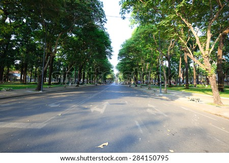 Asphalt road with tree in city - stock photo