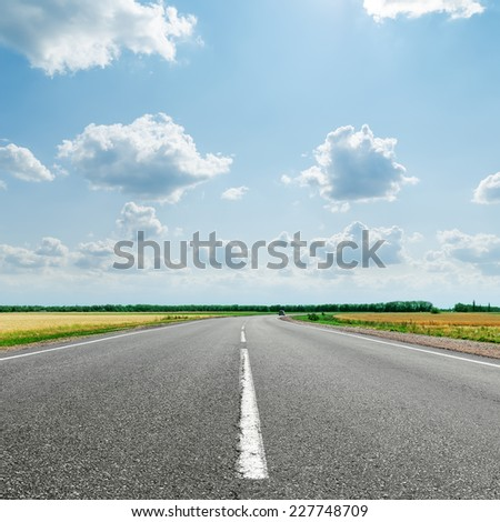 asphalt road with white line to cloudy horizon - stock photo