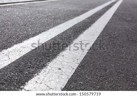 Asphalt road with white lines - stock photo