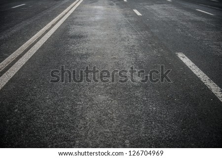Asphalt road with white stripes - stock photo