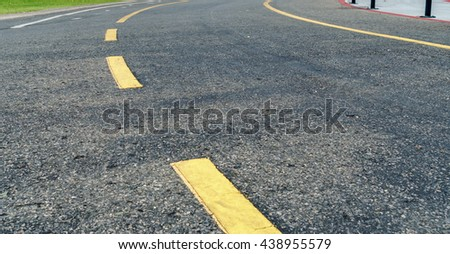 Asphalt road with yellow dot line curve