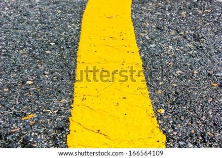 asphalt road yellow line close up background - stock photo