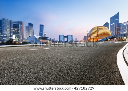 Asphalt roads and beautiful scenery of the city at night in Hangzhou - stock photo