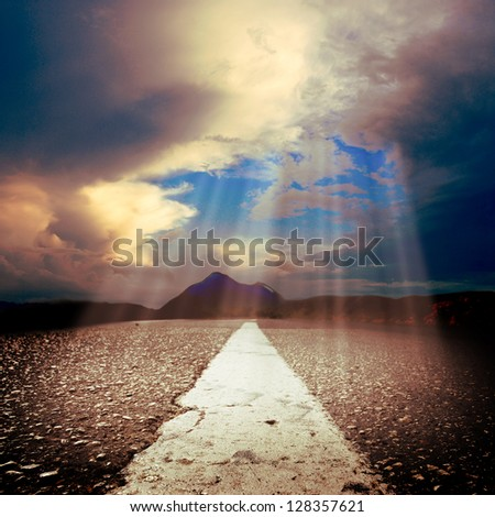 asphalt roat under sun rays - stock photo