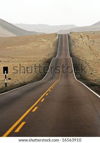 asphalt street in the midle of desert - stock photo