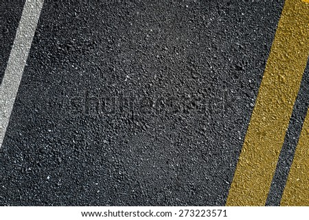Asphalt surface of road with lines - stock photo