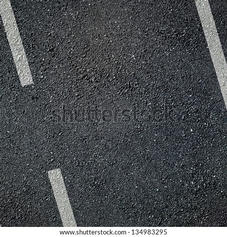 Asphalt surface of road with white lines
