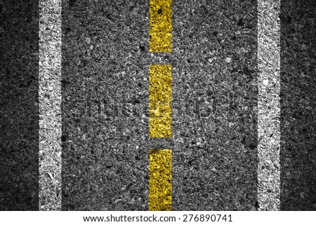 Asphalt surface of road with white lines - stock photo