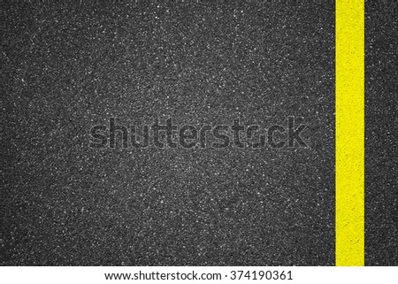 Asphalt texture background with yellow line - stock photo