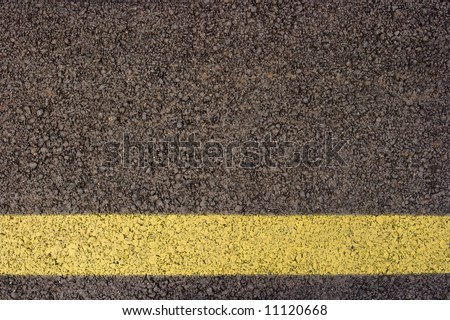 Asphalt texture with yellow line - stock photo